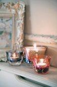 Elegant tealight holders on cabinet