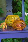 Wickerwork candle lanterns on blue-painted wooden chair