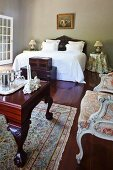 Colonial-style antiques in grand bedroom