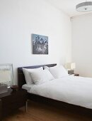 Modern double bed with headboard in simple bedroom