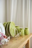 Cheerful, pastel green crockery with white polka dots on wooden table