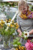 Woman arranging summery bouquet
