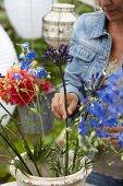 Woman arranging summer bouquet