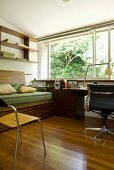 50s-style home office with desk and couch made from exotic wood
