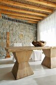Rustic wooden table in front of stone wall