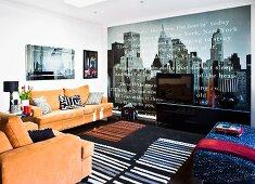 Bright, modern living room with skylight, photo wallpaper of New York skyline and orange sofa set
