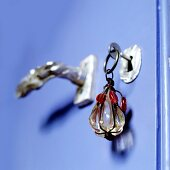 Key with glass pendant in periwinkle blue interior door