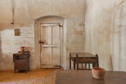 Room in an adobe building with furnishings, at Mission La Purisima State Historic Park, Lompoc, California