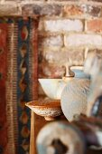 Vintage vase and dish on half-height cabinet in rustic setting