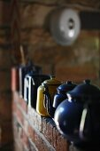 Collection of vintage metal teapots in different colours
