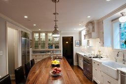 Walnut kitchen island in spacious country-house kitchen