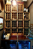 Wine rack made from wooden crates and bottle fridge