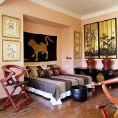 Bedroom in mixture of ethnic styles with antique, Oriental collectors' items