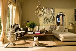Interior in pale natural colours with classic, elegant seating and modern painting of horse in background