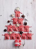 Christmas tree made from small numbered bags and chocolate truffles as baubles