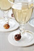 Wine glasses decorated with dolls house cake moulds