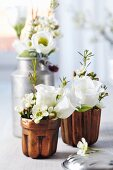 Jelly moulds & small milk can used as vases for waxflowers & lisianthus
