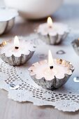 Small cake moulds filled with wax and used as tealights