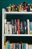 Collection of toys and books on shelving