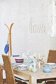 Blue, white and red crockery on wooden table