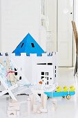 Cardboard toys, building blocks and soft toy on child's chair