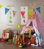 Christmas gifts for a child's bedroom and garden picnics: wigwam, toys, bunting, lamps, picnic case