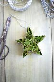 Star-shaped cookie cutters filled with moss