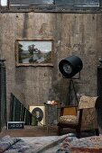Retro armchair and old pictures against vintage wall combined with professional photographers' lamp