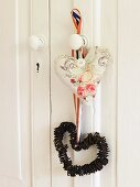 A heart-shaped decorating hanging from a doorknob