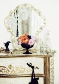 Antique chest of drawers with romantic mirror & bouquet of roses of the varieties 'Lady Emma Hamilton' (orange) and 'Novalis' (pink)