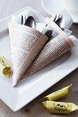 Cutlery in newspaper cones