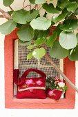 Selbstgemachte Filztaschen mit Rosenmustern