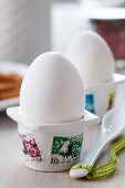 Egg cups decorated with postage stamps