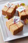Stacked biscuits tied together & decorated with postage stamps