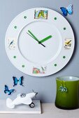 Plate decorated with pretty postage stamps turned into clock
