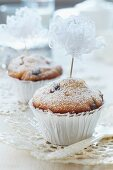 Muffins decorated with flowers hand-crafted from lace ribbon