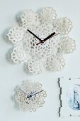 Wall clocks with faces made from stiffened crocheted doilies
