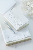 Notebooks with jackets decorated with lace ribbon