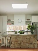 Kitchen island with stainless steel worksurface and base unit with stone facing in white, country-house kitchen