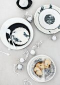 White and blue plates and dried flower bulbs painted white decorating table