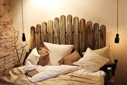 Double bed with headboard made from picket fence