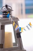 Flags made with decorative masking tape hanging on the string