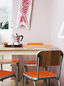Original, 60's, vintage dining set with orange, plastic surfaces and espresso pot on breakfast tray on table