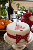 Festive Christmas cake on cake stand