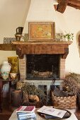 Rustic, country-house-style open fireplace decorated with painting and hand-painted crockery