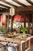 Large kitchen-dining room with wooden table in French country house