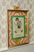 Hand-crafted decoration for child's bedroom on retro wallpaper - vintage postcard with washi tape and 70's wallpaper mount in old metal picture frame