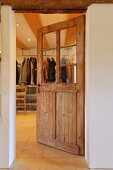 View from foyer into cloakroom through door with glass panels