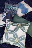 Scatter cushions with green and blue patterns