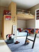Custom loft bed in teenager's bedroom with table football table in foreground